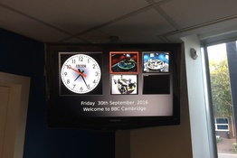 IDS display in Newsroom with clock, status and multiple video feeds, each with tally status bezels.