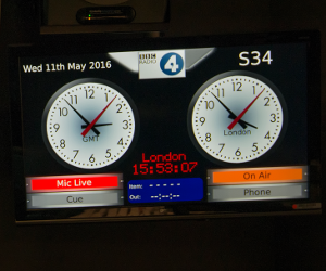 display in TV studio showing digital and analogue clocks