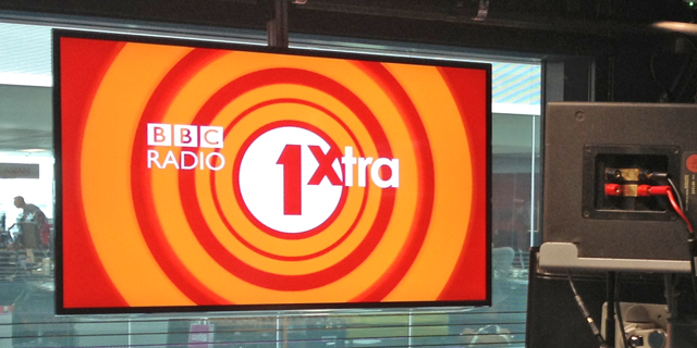 A large branding screen in the new Radio 1 studios